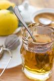 Lemon tea. A glass with lemon tea stock images