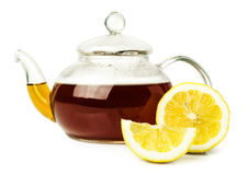Lemon tea in glass teapot Royalty Free Stock Image