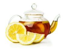 Lemon tea in glass teapot Royalty Free Stock Photos