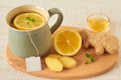 Lemon tea with honey and ginger Stock Images