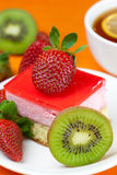 Lemon tea, kiwi,cake and strawberries Royalty Free Stock Images