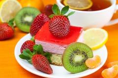 Lemon tea, kiwi,cake and strawberries Stock Photography