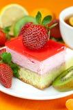 Lemon tea, kiwi,cake and strawberries Stock Photos