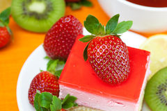 Lemon tea, kiwi,cake and strawberries Stock Image