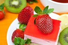 Lemon tea, kiwi,cake and strawberries Stock Image