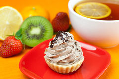 Lemon tea ,lemon,kiwi,cake and strawberries Royalty Free Stock Photography