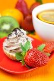 Lemon tea ,lemon,kiwi,cake and strawberries Royalty Free Stock Photo