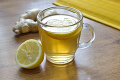 Lemon tea with lemon pieces and ginger on the table Royalty Free Stock Photo