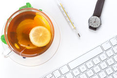 Lemon Tea with mercury thermometer Stock Images