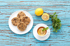 Lemon tea mint fresh drink raisin cookies summer refreshment still life Royalty Free Stock Image
