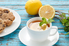 Lemon tea mint fresh drink raisin cookies summer refreshment still life Royalty Free Stock Photography