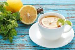 Lemon tea mint fresh drink summer refreshment still life. Blue background wood teak stock images