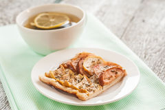 Lemon tea and a piece of apple pie Stock Image