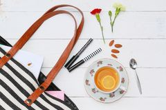 Lemon tea and purse accessories stock photography