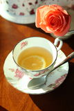 Lemon tea and rose. Tea cup and teapot with lemon and rose on the table Stock Images