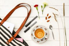 Lemon tea and purse accessories stock image