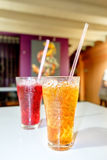Lemon tea Thai herbal drinks with ice in glasses. Lemon tea Thai herbal drinks with ice in glasses on the blurred cafe background Stock Images