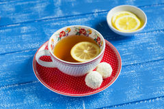Lemon tea in a vintage Cup and candy Royalty Free Stock Photo
