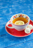Lemon tea in a vintage Cup and candy Stock Photography