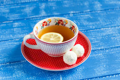 Lemon tea in a vintage Cup and coconut candy Royalty Free Stock Image