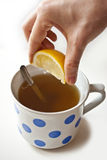 Lemon tea in vintage cup. Lemon tea in vintage dots cup Royalty Free Stock Image
