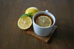 Lemon tea on wood background. Lemon tea with mint leaf on wood background Royalty Free Stock Photo