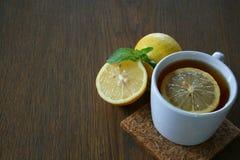 Lemon tea. On wood blackground Royalty Free Stock Images