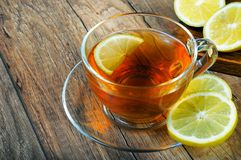 Lemon tea with on wood table stock photo