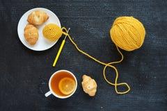 Lemon tea, yellow crocheting and croissants Royalty Free Stock Photos