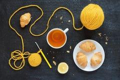 Lemon tea, yellow crocheting and croissants Royalty Free Stock Image