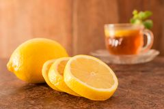 Lemon and Teacup. With lemon slices and mint leaf on a wooden background. Beverage concept, Close-up, Selective Focus Stock Images