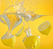 Lemon thrown into the water with splash Stock Photos