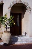 Lemon tree in doorway - Mediterranean scene. A potted lemon tree on the stoop of a doorway - typical Mediterranean scene and architecture Royalty Free Stock Photo