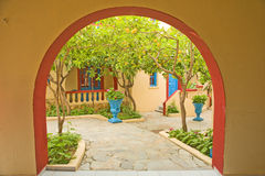 Lemon trees seen through an arch. Royalty Free Stock Image