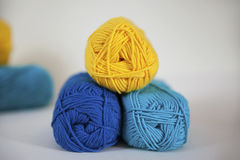 Lemon, turquoise and blue cotton yarn for knitting, needlework, or crochet projects. Horizontal shot of lovely range of cotton in bright, strong colors for Stock Photo