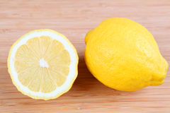 Lemon. Two lemons on a cutting board Stock Photography