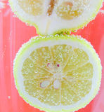Lemon under the sparkling water. Yellow lemons in the sparkling water Stock Image