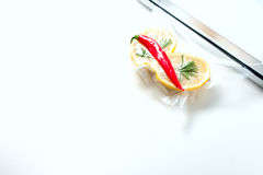 Lemon in a vacuum package. Sous-vide, new technology cuisine. Royalty Free Stock Images