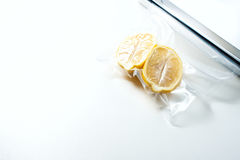 Lemon in a vacuum package. Sous-vide, new technology cuisine. Royalty Free Stock Photo
