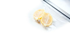 Lemon in a vacuum package. Sous-vide, new technology cuisine. Royalty Free Stock Photos