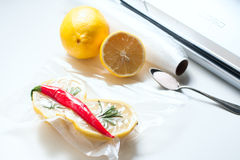 Lemon in a vacuum package. Sous-vide, new technology cuisine. Stock Photography