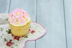 Lemon or Vanilla Flavored Cupcake Stock Photos
