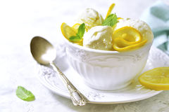 Lemon vanilla ice cream with in a white vintage bowl. Royalty Free Stock Image