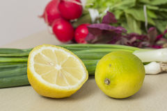 Lemon and vegetables. Fresh lemon, radishes and other vegetables Stock Photo