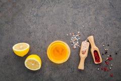 The lemon vinaigrette dressing ingredients lemon, olive oil, him Stock Image