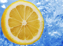 Lemon in a water Royalty Free Stock Image