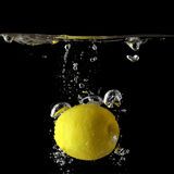 Lemon in water. Stock Photos