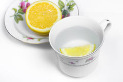 Lemon Water. Hot lemon water in a delicate china cup Stock Photo