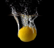 Lemon in water. Royalty Free Stock Photography