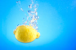 Lemon in water Stock Photos